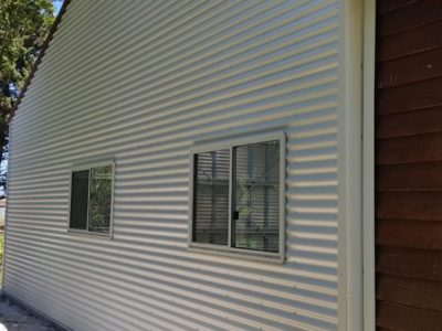 Garaport attached to existing annexe with horizontal cladding 9m x 15m x 3.2m (4)